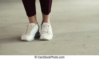 Girl Skips Rope - Girl in white sneakers and black leggings...