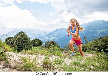 Girl skyrunner in action during uphill mountain race
