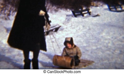 Girl Sledding With Her Mom (1942)