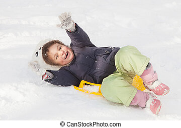 Girl sledging down hills winter