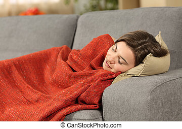 Girl sleeping on a couch at home