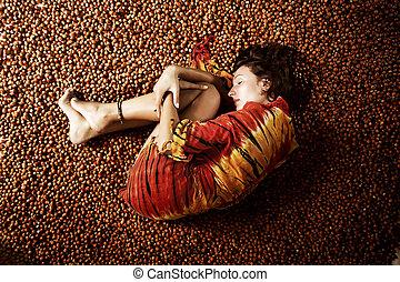 girl sleeping on a hazelnuts