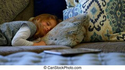 Girl sleeping on sofa in living room 4k