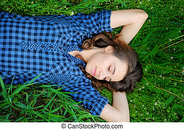 girl sleeping on the grass