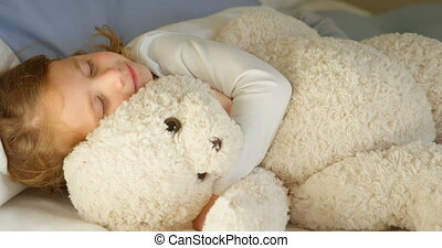 Girl sleeping with teddy bear in bedroom 4k