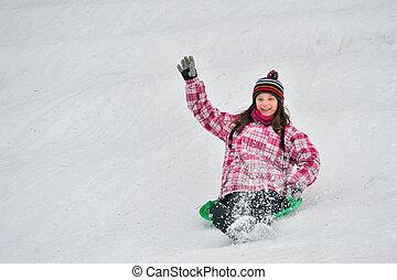 girl sliding in the snow