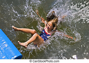 Girl Sliding into the Water