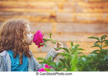 Girl smelling a bouquet of daisies, photo in the profile. ...