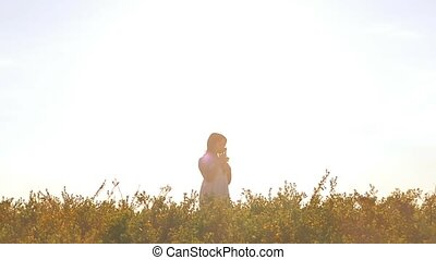girl smelling a bouquet of slow motion video - in the summer...