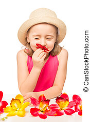 girl  smelling a branch of pink orchids on a white background