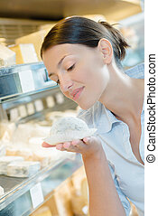 girl smelling a cheese