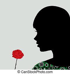 Girl smelling a rose