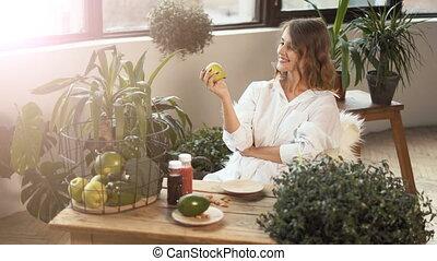 Girl Smells Green Apple