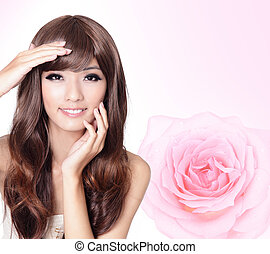 Girl smile face close up with pink rose background