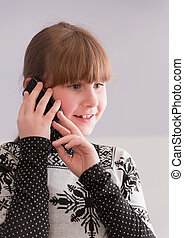 Girl smiling and talk on telephone