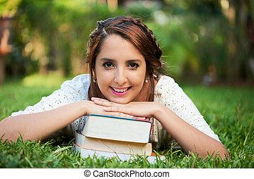 girl smiling on books