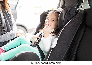 Girl Smiling On Car Seat