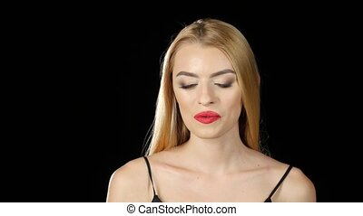 Girl smokes an electronic cigarette in a dark room. Black...