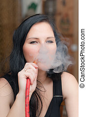 girl smoking a hookah - Portrait of the girl smoking a...