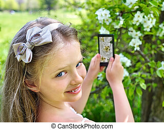 Girl snapshot blossoming tree. - Girl snapshot blossoming...