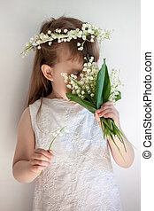 girl sniffing a bouquet