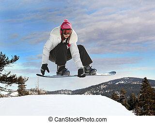 Girl snowboarding - Young mexican girl jumping on a...
