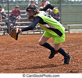 Girl Softball Player - A young girl with ball in hand racing...