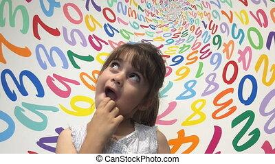 Girl solving arithmetic problem - Little girl solving...