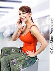 girl speaks on telephone l