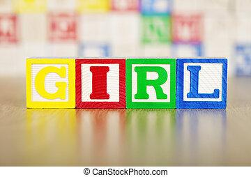 Girl Spelled Out in Alphabet Building Blocks