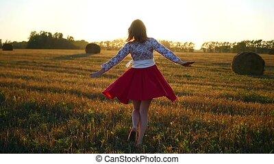 girl spinning a beautiful dress at sunset