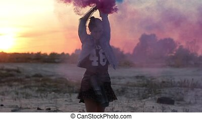 Girl spinning with smoke bombs in her hands