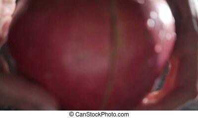 Girl splitting big ripe pomegranate
