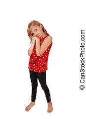 Girl standing in studio.