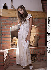 Girl standing near fireplace