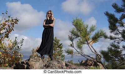 girl standing on a hill