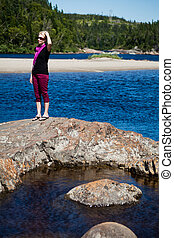 Girl standing on a rock
