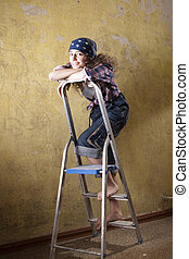 girl standing on the ladder