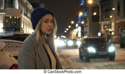 Girl standing on the road in winter