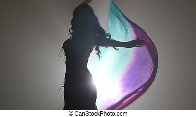 Girl starts dancing belly dance with multicolored shawl....