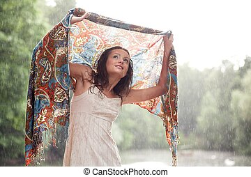 Girl stay under rain drops cover shawl