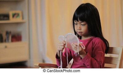 Girl Stitching A Heart Shape Design - A cute little 5 year...