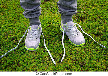 girl stopped running to tie the laces on shoes. - girl...