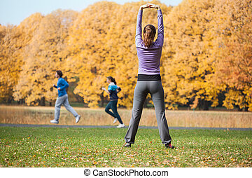 Girl stretching in park