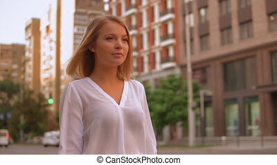Girl stroll in town summer season - happy businesswoman...