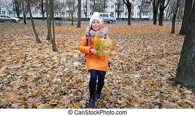 Girl student is playing with leaves in autumn Park - Girl...