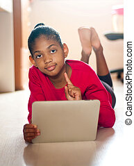 girl studies and plays with a tablet.