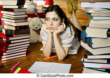 Girl-Studying 01 - Girl studying surrounded by books