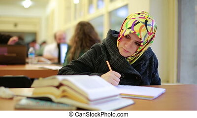 Girl studying in library