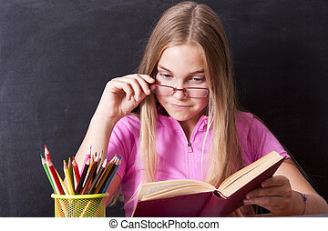 girl studying in the school table
